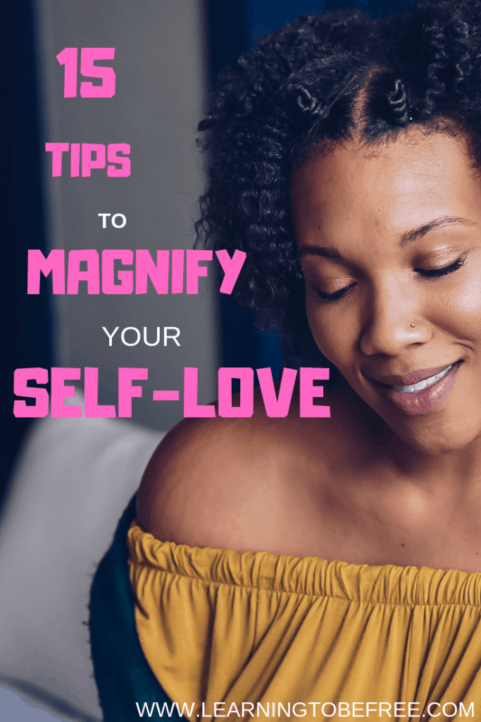 Black woman who looking down with slight smile with text that reads 15 Ways to Magnify Your Self-Love